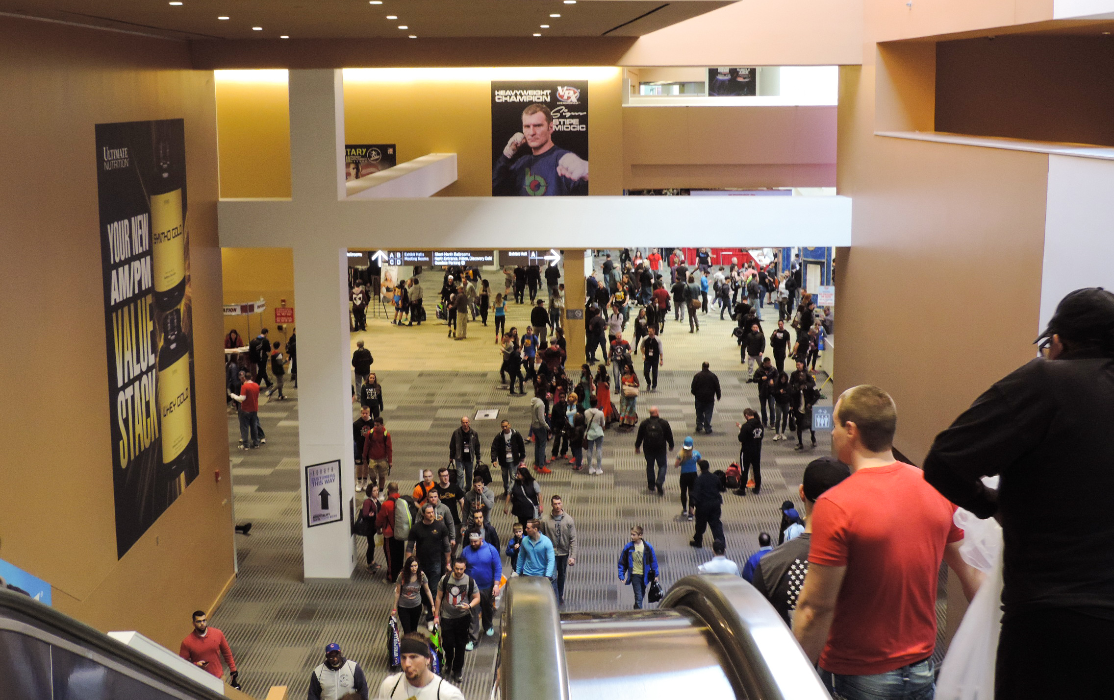 Entrance to the Arnold Sports Expo. Crowds of people starting to arrive.