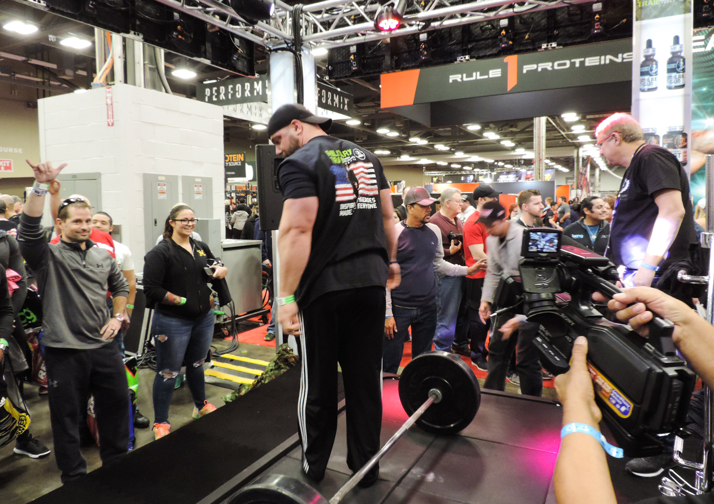 Weight lifting challenge at the Midway Labs booth.