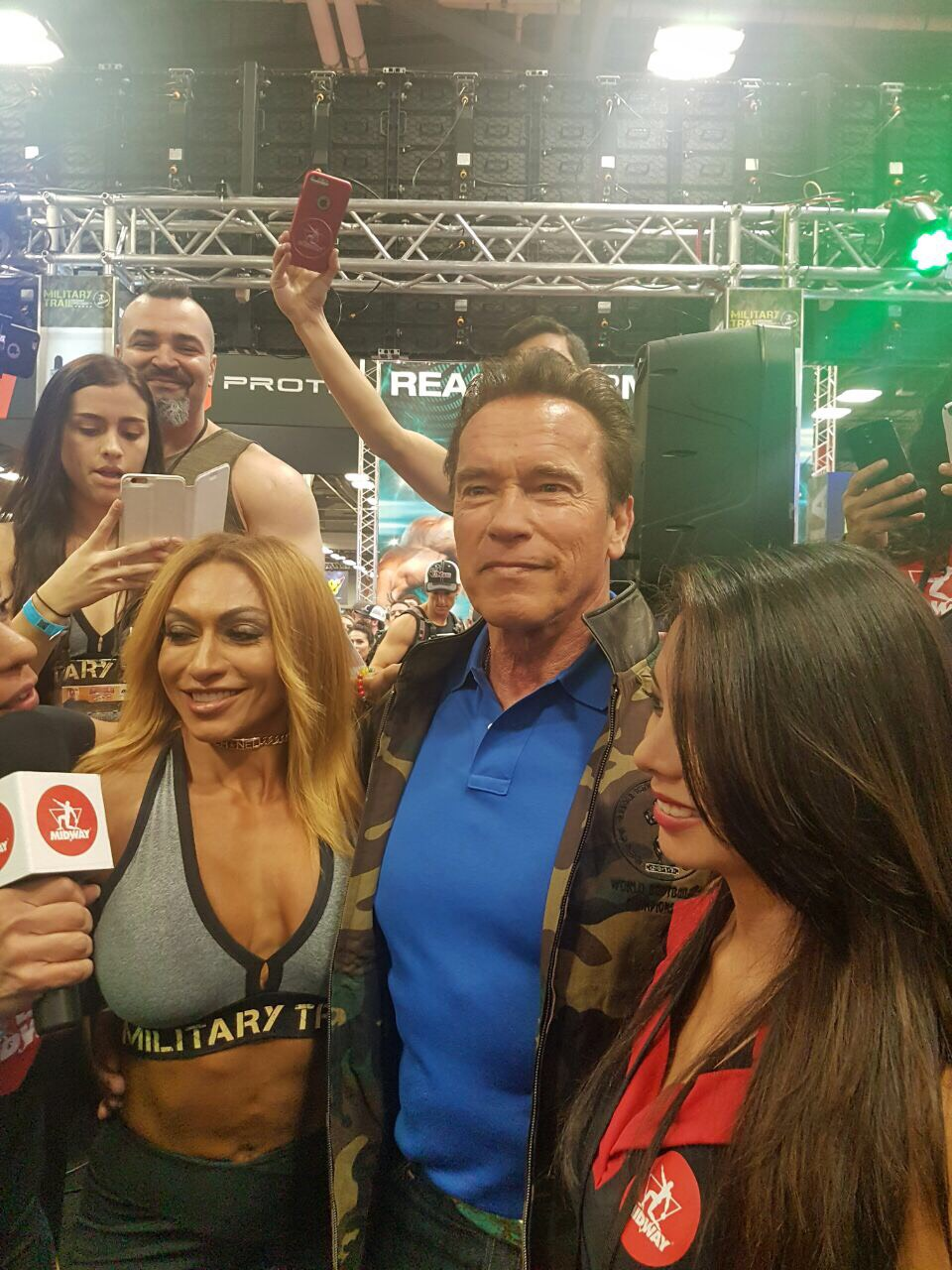 Karina Nascimento & Midway Labs VP Catherine Colle posing for a picture with Arnold.