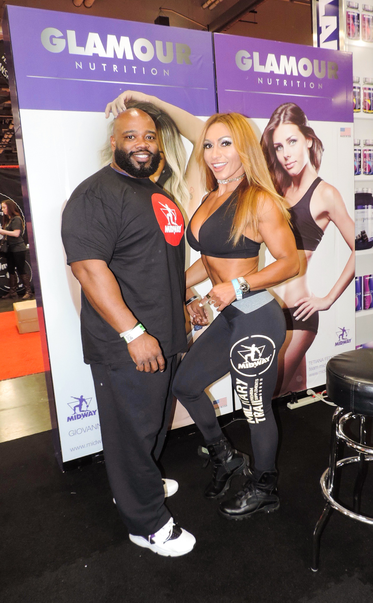 Karina Nascimento posing for a picture with a fan.