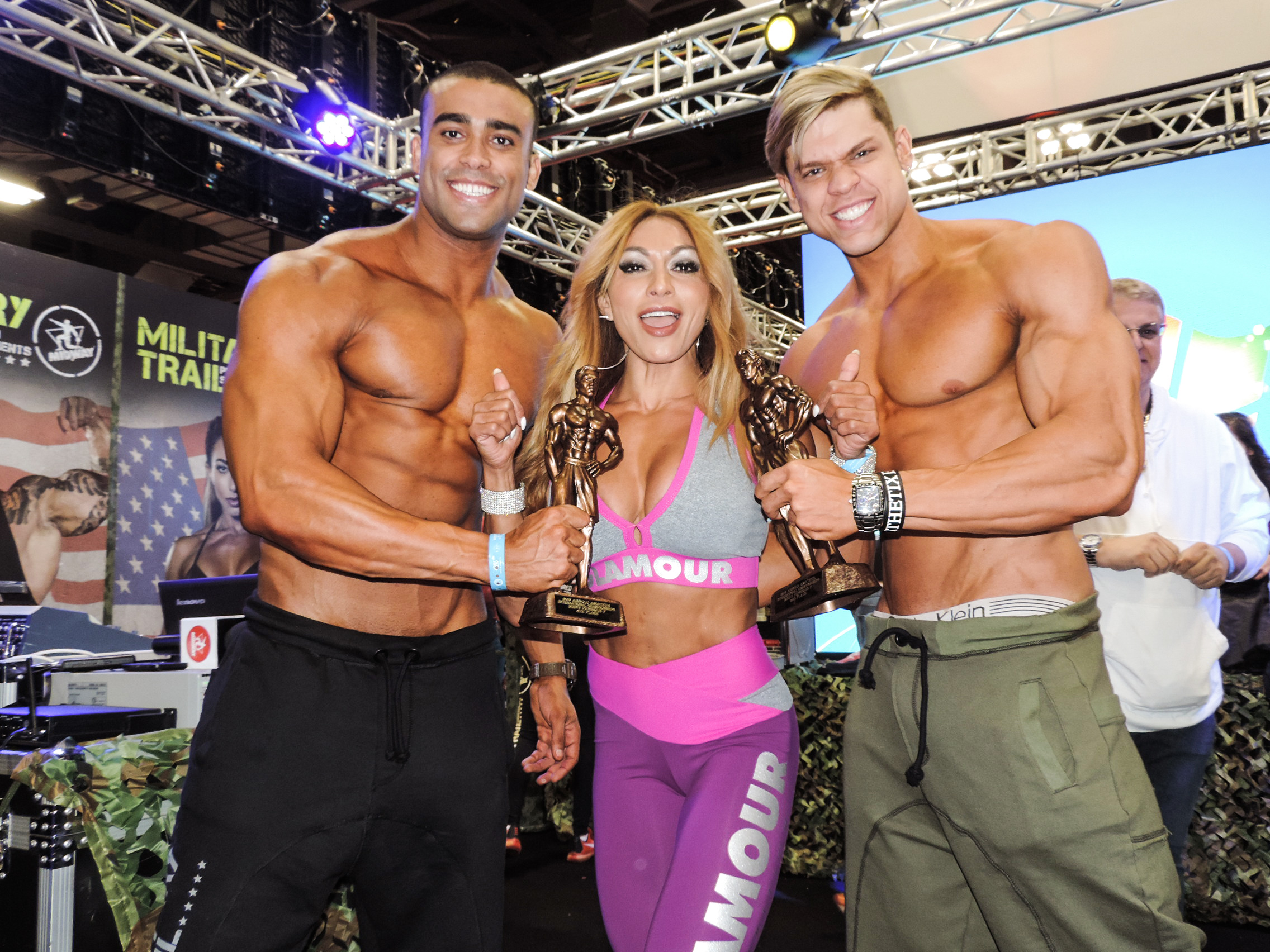 Romulo Rocha & Eric Wildberger showing off their trophies with Karina Nascimento.
