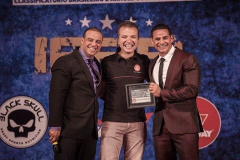 Jason Marrom and Adriano de Paula receiving award